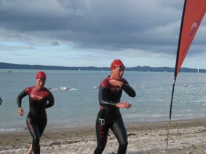 Kirsty Whiting leads Debbie Tanner up the beach