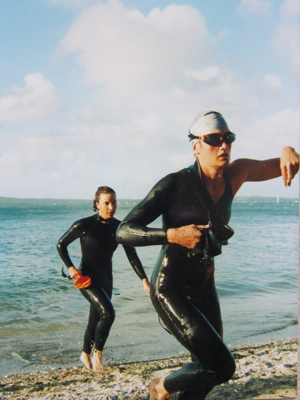 Louise Soper leads Marisa Pentecost from the water