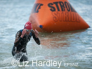 Sophie Corbidge leads from the water