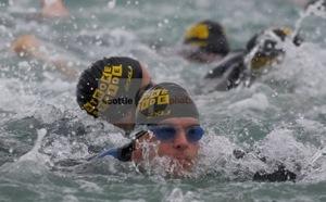The men's field churn through the swim